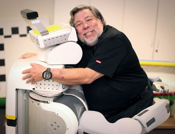 Steve Wozniak receives a hug from a PR2 robot
